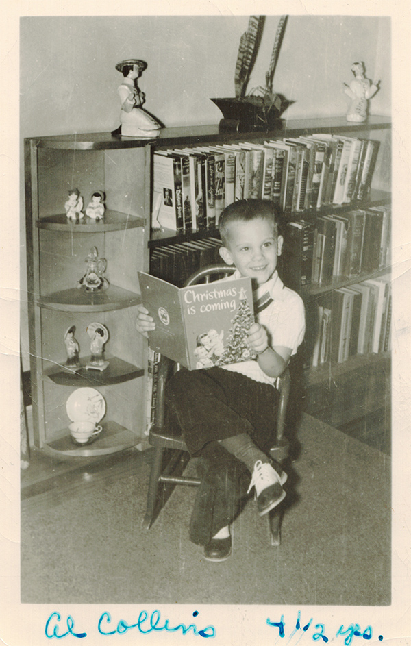 Max Allan Collins Jr., Age 4-and-a-half, seated in a rocking chair and reading a book titled